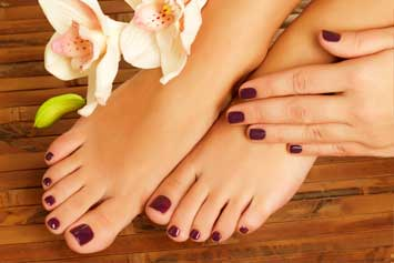 woman-with-beautiful-manicure-and-pedicure